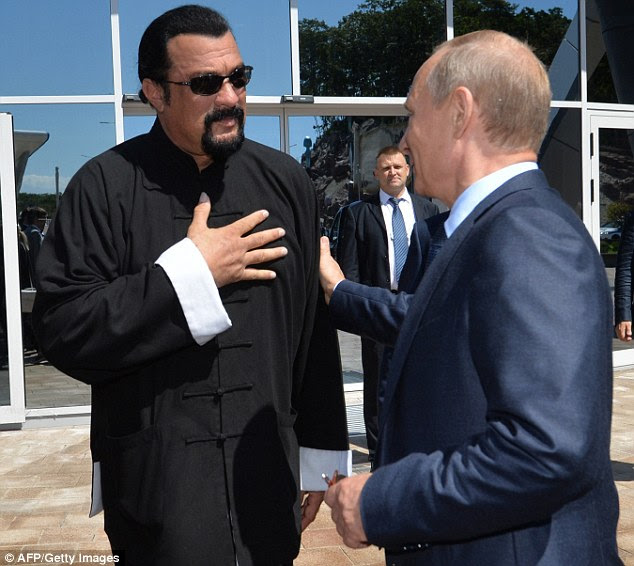 Vladimir Putin speaks with Steven Seagal who is said to be one of the president's favourite celebrity icons