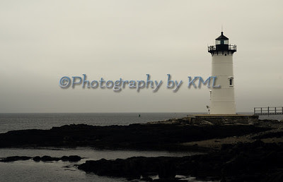 new castle lighthouse on a gray day