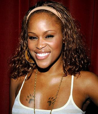 Celebtity Tattoos on Rapper Eve   S Chest Paw Tattoo Photo  Celebrity Tattoos   First Class