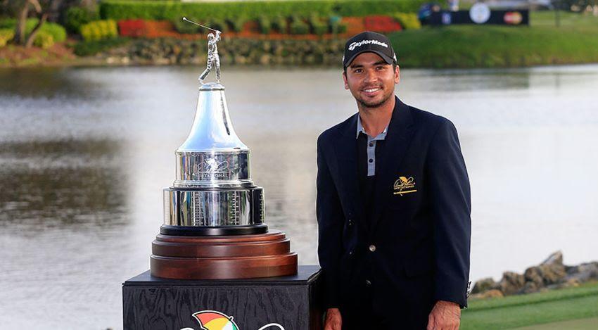 Jason Day with API trophy
