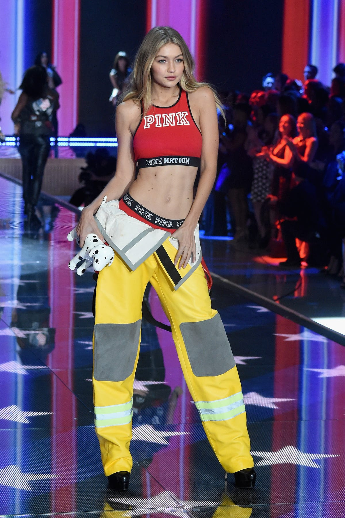 Gigi Hadid showed off her firewoman tendencies in the PINK section of the show.