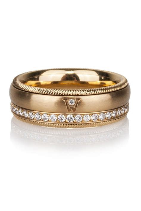 Gold & diamond spinner ring by German Jewelry Designers