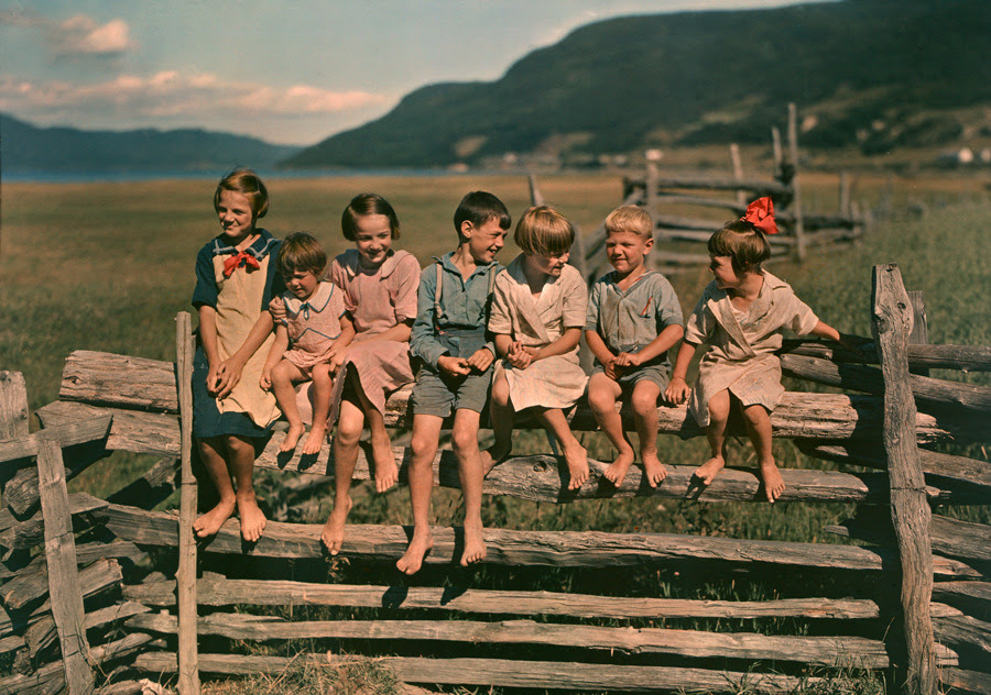 Seven siblings sit on a wooden fence in Quebec, Canada, May 1939.Photograph by Howell Walker, National Geographic