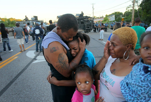 As dusk falls on Ferguson, Mo., a new man takes control of the police