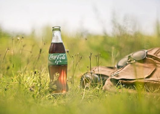 Coca-Cola Unveils Healthier Coke With Green-Labeled Packaging - DesignTAXI.com