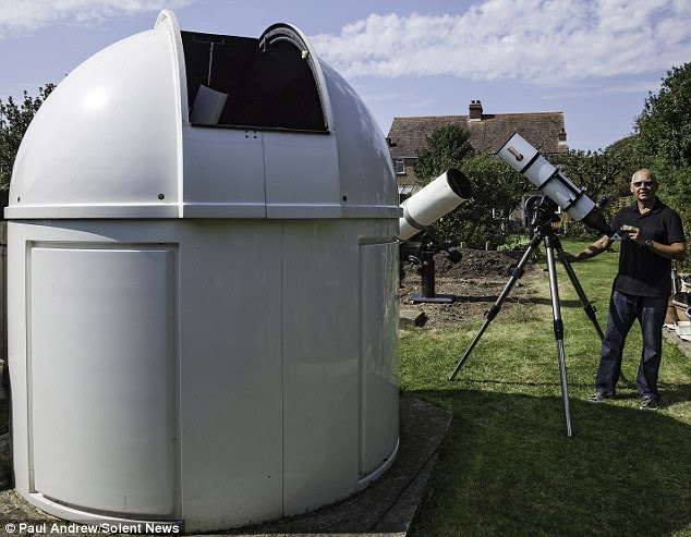 Paul Andrews in his garden observatory, which - ignoring the clouds - allows him to capture the spectacular images