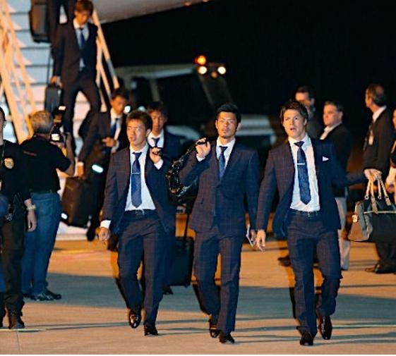 Jogadores desembarcam no Aeroporto Viracopos, em Campinas. Foto: Jiji Press