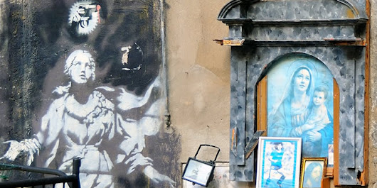 "Foto, ""Madonna with the gun"", made by Banksy in the Girolamini square in Naples."