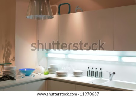 Modern Beige Kitchen With Blue Tureen And Shade On The Wall Stock ...