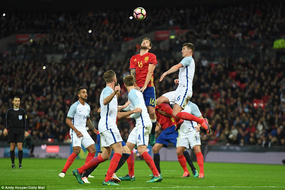 Spain's 25-year-old Real Sociedad centre half Inigo Martinez rises highest during a set-piece for the visitors