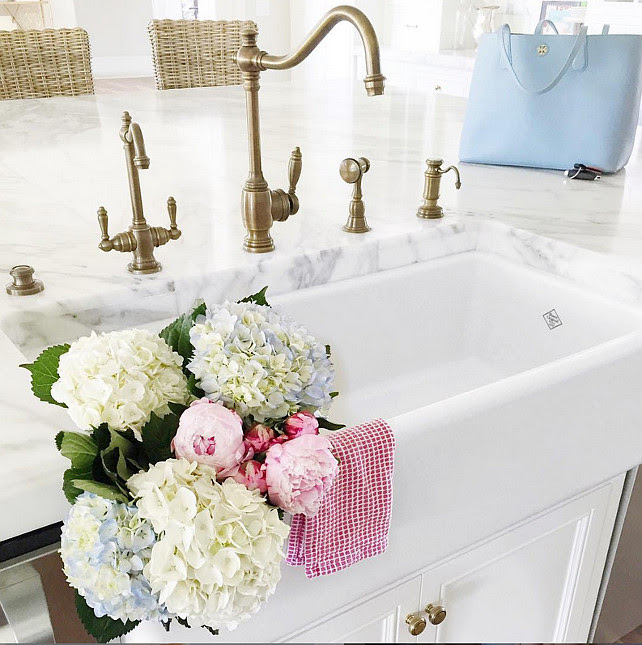 Top Kitchen Faucet Pin. Kitchen Island with Farmhouse sink and brass kitchen faucet. Via Pink Peonies.