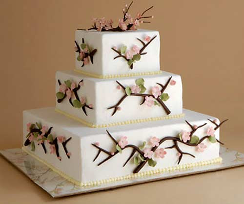 Three tier square white cherry blossom wedding cake hand decorated with