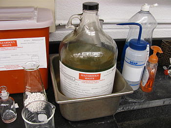 Hazardous waste bottle in a chemical lab
