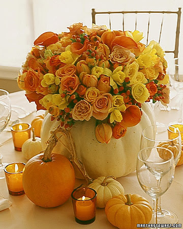 I love this centerpiece too found here which consist of smaller pumpkins