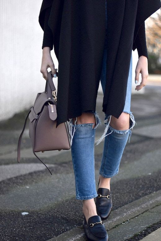 Le Fashion Blog Blogger Style Black Cape Celine Purse Light Wash Distressed Cropped Jeans Gucci Leather Horsebit Slingback Loafers Via Shot From The Street