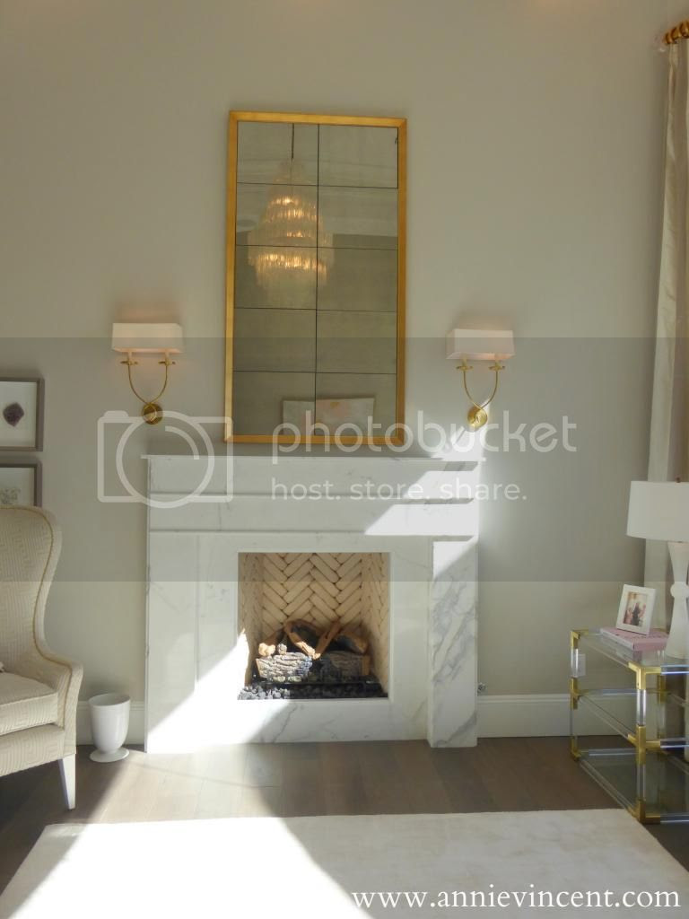 gold antique mirror above fireplace modern home neutral living room