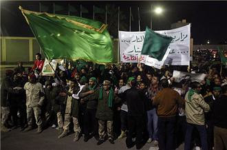 Thousands of Libyans stand as human shields against the U.S./European imperialist bombing of that North African state. The NATO forces are continuing their onslaught on this country. by Pan-African News Wire File Photos