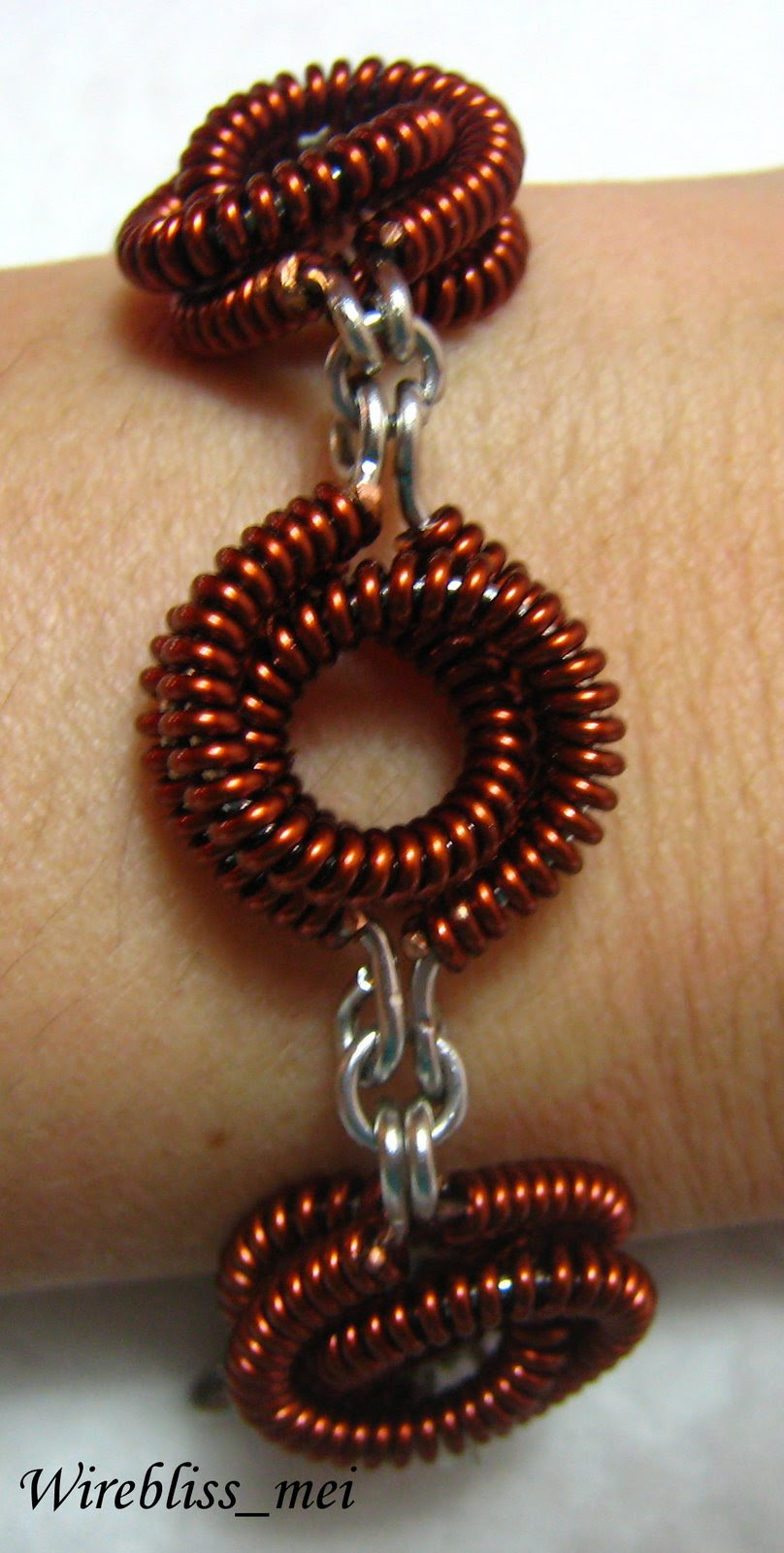 Wire wrap copper bracelet around wrist