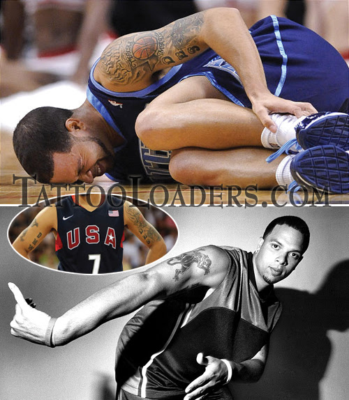 Utah Jazz is a great basket ball player with some tattoos on his arms.