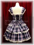 Tartan Check Shirring JSK, Brand: Baby the Stars Shine Bright Product ID: 130�224 Release Year: 2006 Price: ¥23,940 Available Colors: Saxon Blue, Navy, Pink, Black Measurements: 91cm length, free-size bust, free-size waist Materials: Fabric (100% cotton), lining (100% polyester) Additional Information: The dress has front and back shirring.