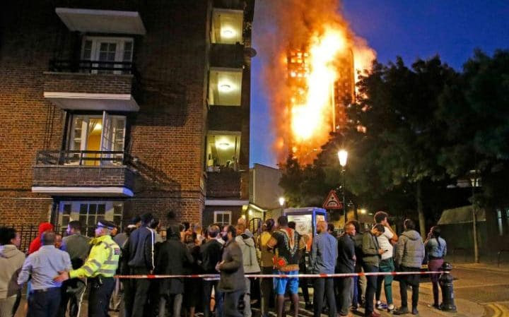 Flames engulfGrenfell Tower as west London residents watch on