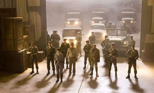 Soviet agents dressed as American soldiers escort Indy into an Area 51 hangar in INDIANA JONES AND THE KINGDOM OF THE CRYSTAL SKULL.