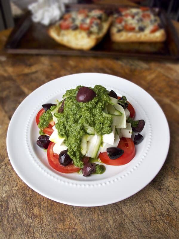 Tomato mozzarella salad with basil pesto