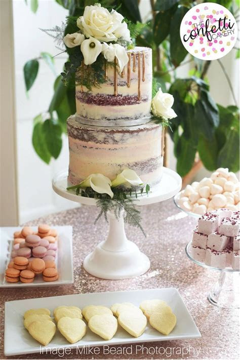 Semi naked buttercream wedding cake with gold chocolate
