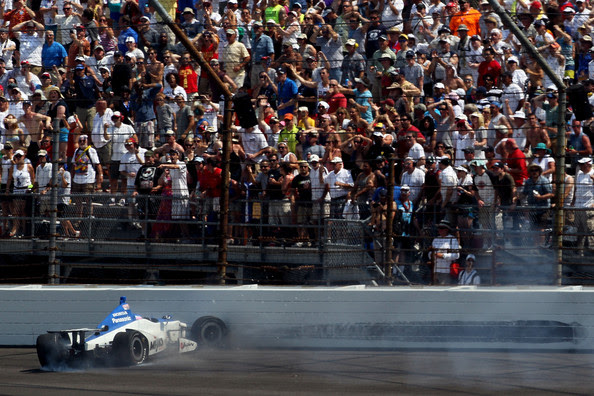 Takuma Sato, driver of the #15 Rahal Letterman Lanigan Racing Honda hits the wall as he wrecks on the final lap while challenging for the potential win during the IZOD IndyCar Series 96th running of the Indianpolis 500 mile race at the Indianapolis Motor Speedway on May 27, 2012 in Indianapolis, Indiana.