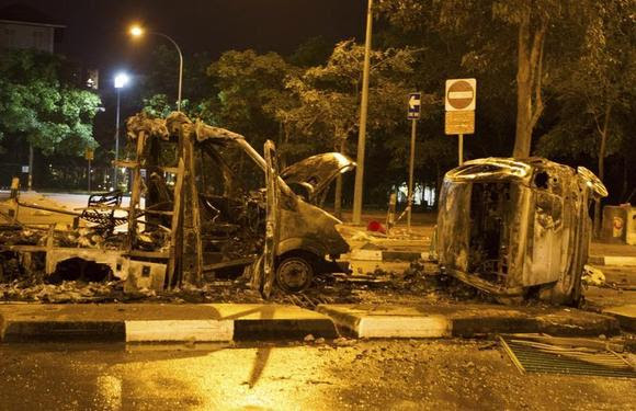 The burnt shells of vehicles are pictured along Race Course Road following a riot near Singapore's Little India district December 9, 2013.REUTERS/Stringer