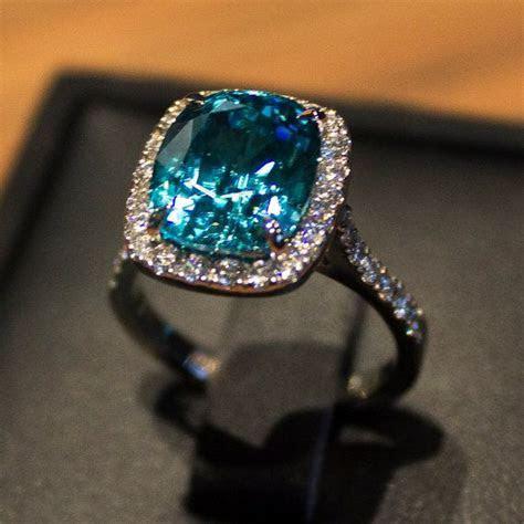 7.5ct Blue Zircon Cushion Cut Ring with Pave Diamond Halo