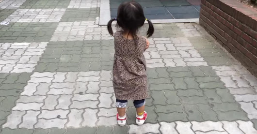 Grouchy little girl just can't stay mad wearing squeaky shoes