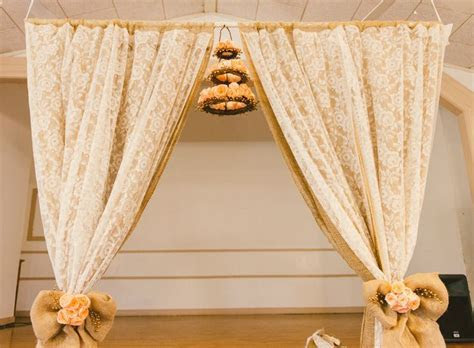 DIY wedding arch. Lace curtains from thrift store and long
