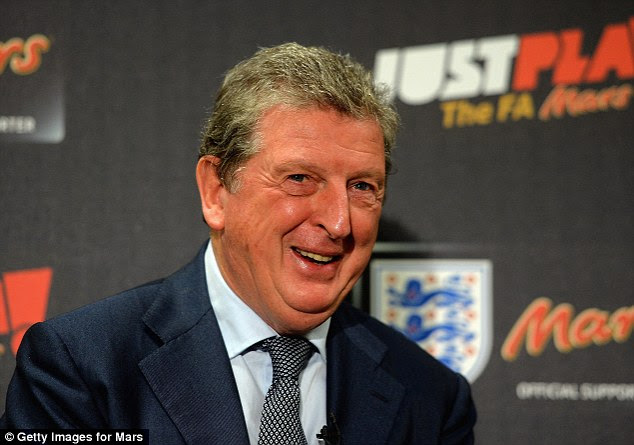 All smiles: But Roy Hodgson's men could face a 'group of death' with Brazil, USA and France