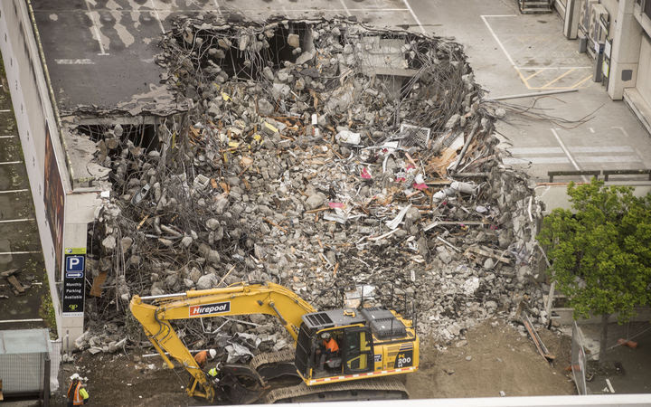 Demolition begins on 61 Molesworth Street in Wellington's CBD, starting with the car park building next door.