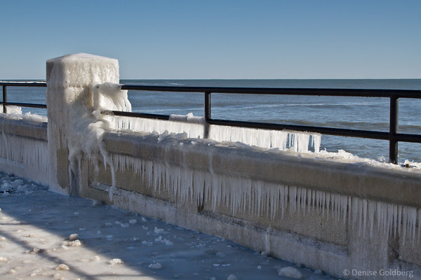 ocean waves crashing beyond the beach creates icicles Hampton Beach, NH