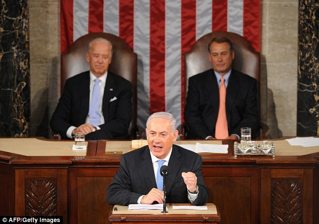 Netanyahu addressed a joint session of Congress in May 2011, and he's coming back in March – but Vice President Joe Biden (left) won't be there