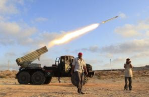 Libyan rebel fighters fire a grad rocket at the front line west of the rebel-held city of Misrata June 15, 2011. REUTERS/Zohra Bensemra (LIBYA - Tags: CONFLICT)