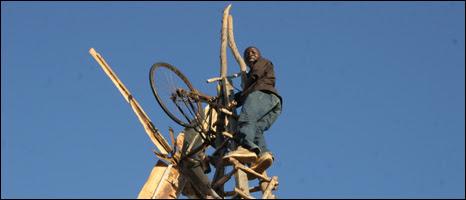 William Kamkwamba up one of his windmills