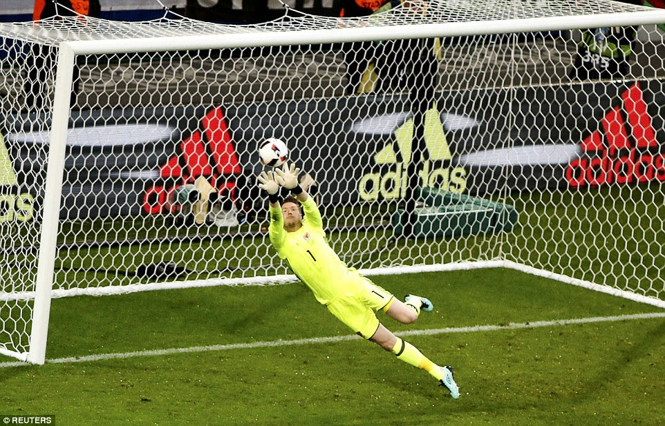Wales goalkeeper Wayne Hennessey opted to go for the ball two-handed, and although he got fingertips to the ball he could not stop it