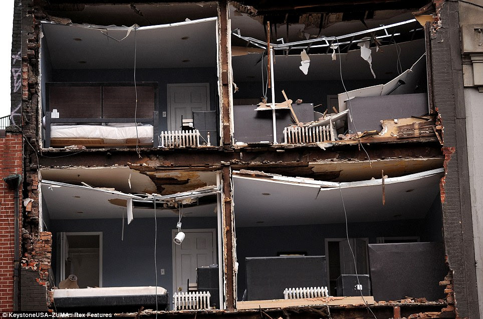 Homes ripped apart: The facade of this New York apartment building was knocked off by Sandy