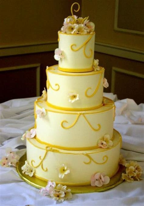 Elegant four tier wedding cake with fresh flower petals