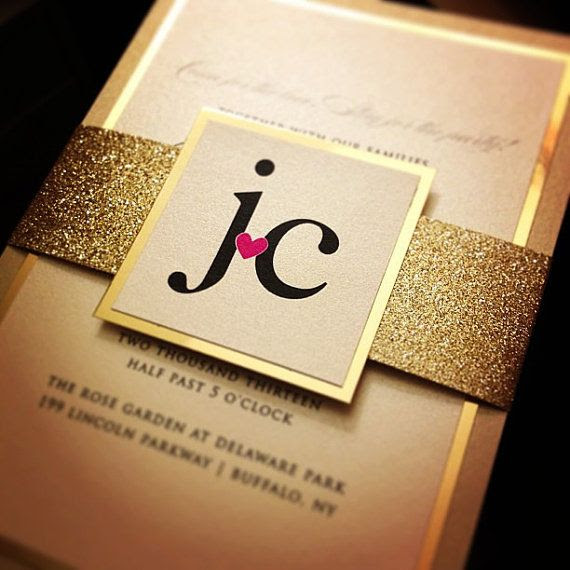 I like the idea of a simple invite with a gold wrap to hold it all together.