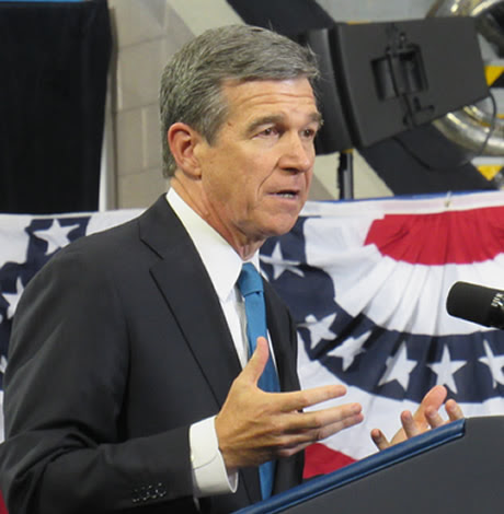 Cooper signs deal to replace HB2 as LGBT advocates cry betrayal
