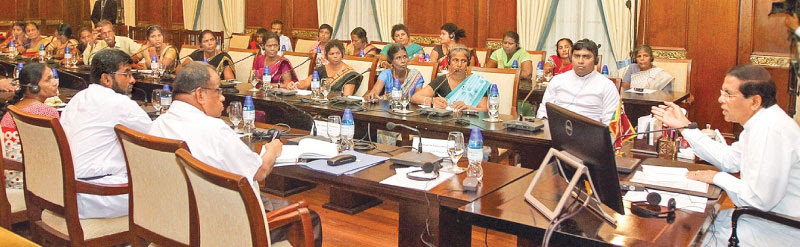 President Maithripala Sirisena met family members of the disappeared and officials yesterday to discuss issues ranging from the present status to the way forward. President's Secretary Austin Fernando and National Integration and Reconciliation Ministry Secretary V. Sivagnanasothy and officials were present. Picture by Udesh Gunaratne.