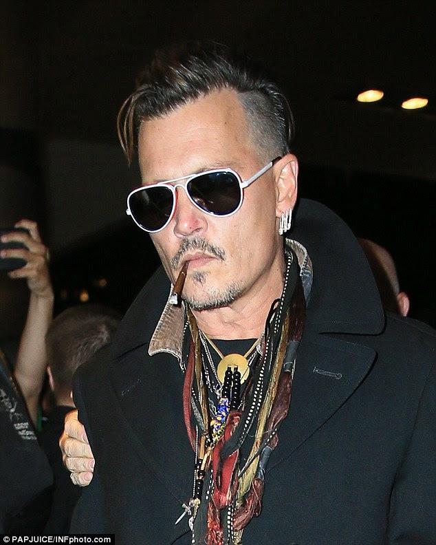 novo começo: Depp, 53, fotografado em Nova York, em julho, negou as acusações de violência doméstica contra ele.  Uma fonte disse que quer colocar seu casamento com Heard trás e seguir em frente