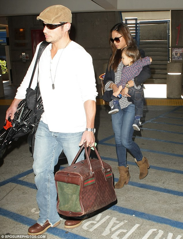 Leading the way: Nick Lachey led his wife Vanessa Minnillo and son Camden to their car after arriving at the Los Angeles International Airport on Saturday
