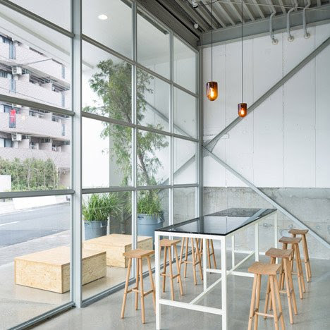 Schemata Architects inserts coffee shop into Tokyo warehouse