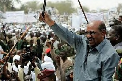 Sudan President Omar Hassan al-Bashir in south Darfur on March 18, 2009. The president called for the Darfur rebels to lay down their arms and talk peace with the government. by Pan-African News Wire File Photos