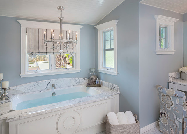 Bathroom. Elegant blue bathroom. Chandelier is from Currey & Company. Paint Color is Dunn-Edwards' Alaskan Skies. #BathroomDesign #Bathroom